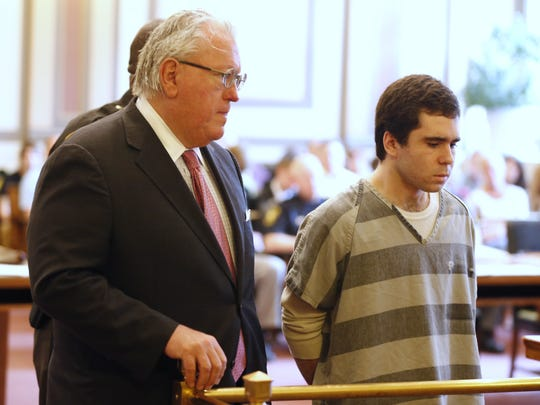 Kyle Stein stands with his attorney, Scott Croswell, as he is sentenced in the courtroom of Judge Steve Martin on Tuesday.