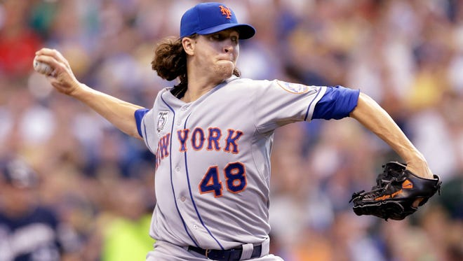 Mets starting pitcher Jacob deGrom was named NL Rookie of the Year on Monday.