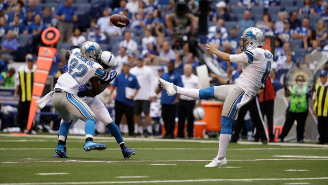 Sam Martin punts to the Colts during the second half Sunday.