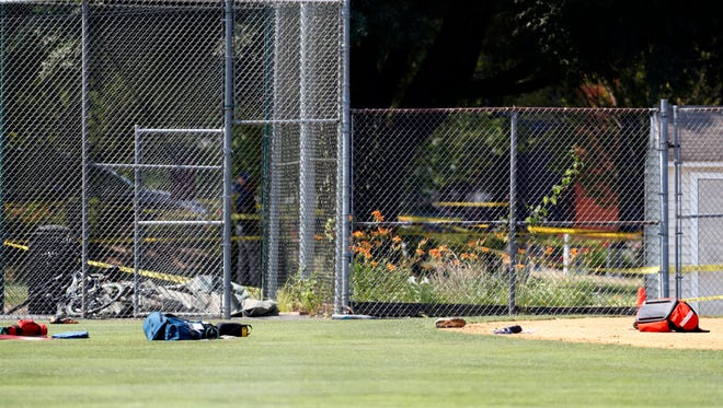 Equipment and medical bags are seen on the baseball field in Alexandria, Va., Wednesday, June 14, 2017, after a shooting where House Majority Whip Steve Scalise of La., and others were shot during a congressional baseball practice.