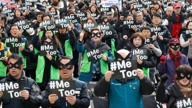 Participants show their support for the 'Me Too' movement during a rally for women laborers by the Korean Confederation of Trade Unions, coinciding with International Women's Day, in downtown Seoul, South Korea, March 8, 2018.