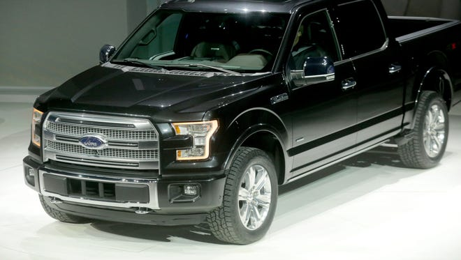 The 2015 Ford F-150 is revealed to the media during the 2014 North American International Auto Show held at Joe Louis Arena in downtown Detroit on Monday, January 13, 2014.