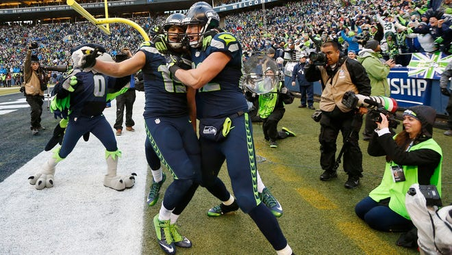 Seahawks wide receiver Jermaine Kearse (15) celebrates with tight end Luke Willson after catching the game-winning touchdown pass against Green Bay.