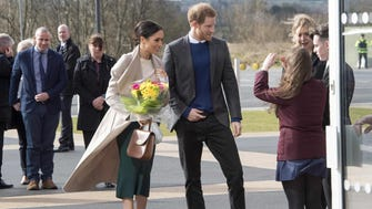 Britain's Prince Harry and US actress and fiancee of Britain's Prince Harry Meghan Markle arrive at the Eikon Centre in Lisburn, on March 23, 2018, to attend an event to mark the second year of youth-led peace-building initiative Amazing the Space.  / AFP PHOTO / POOL / ARTHUR EDWARDSARTHUR EDWARDS/AFP/Getty Images ORIG FILE ID: AFP_1319QE
