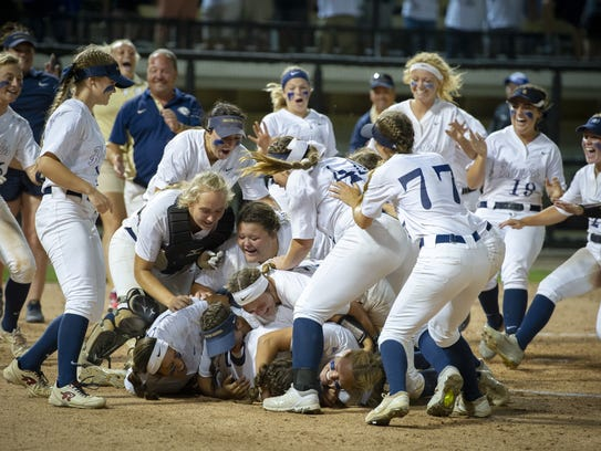 The Decatur Central High School team celebrates after
