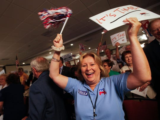 Kent County delegate Bonnie McCann cheers as Republican presidential candidate Carly Fiorina is introduced at the Delaware GOP convention in Wilmington on Saturday.