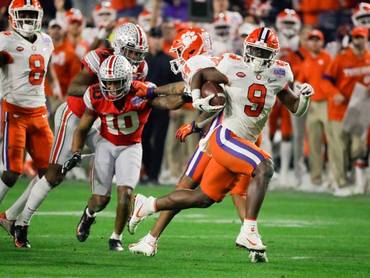 Clemson running back Travis Etienne runs for a touchdown against Ohio State during the second half of the Fiesta Bowl NCAA college football playoff semifinal Saturday, Dec. 28, 2019, in Glendale, Ariz. (AP Photo/Rick Scuteri)