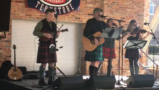 A Celtic band plays Irish music at this year's Return to the Green at Fluor Field on March 4.