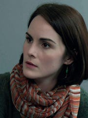"""Michelle Dockery is Claire, the activist daughter of a billionaire industrialist, in """"Self/less."""""""
