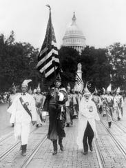 Members of the Ku Klux Klan march in Washington, D.C.,