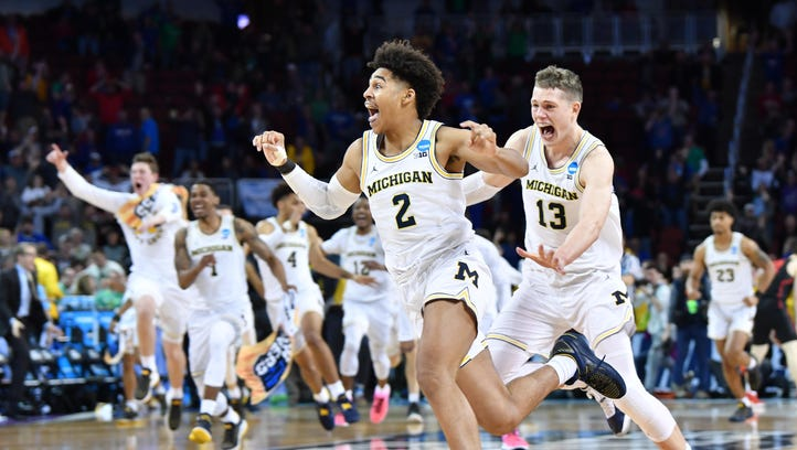 Michigan Wolverines guard Jordan Poole (2) celebrates