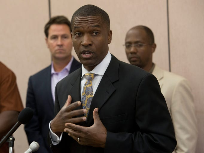 The Rev. Lonnie Wesley, of the First West Florida Baptist District Association, speaks during a press conference at St. John The Divine Baptist Church Monday morning June 16, 2014.