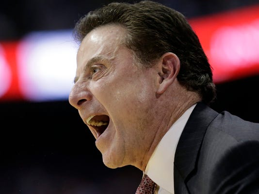 Louisville Cardinals head coach Rick Pitino yells during the first half of an NCAA college basketball game against North Carolina in Chapel Hill, N.C., Wednesday, Feb. 22, 2017. North Carolina won 74-63. (AP Photo/Gerry Broome)