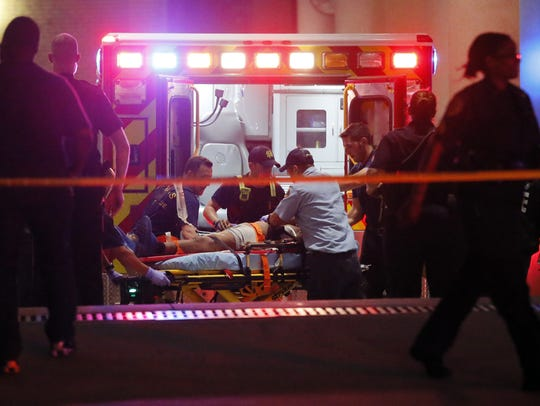 Emergency responders administer CPR to an unknown patient