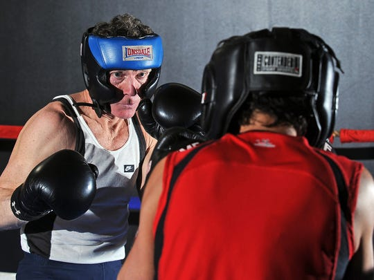 Jeffrey LeMair, left, spars with Kit McCahren at the Tiger Academy boxing ring in 2012. LeMair is a member of the South Dakota Sports Hall of Fame.