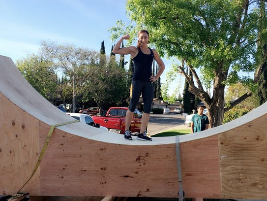 Zhanique Lovett, of Visalia, prepares to install a