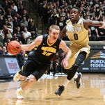 Iowa Hawkeyes guard Mike Gesell (10) drives to the basket against Purdue Boilermakers guard Jon Octeus (0) at Mackey Arena.