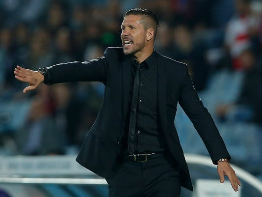 Atletico's coach Diego Simeone gestures during a Spanish La Liga soccer match between Atletico de Madrid and Getafe at the Coliseum Alfonso Perez stadium in Madrid, Spain, Sunday, Oct. 26, 2014. (AP Photo/Andres Kudacki)