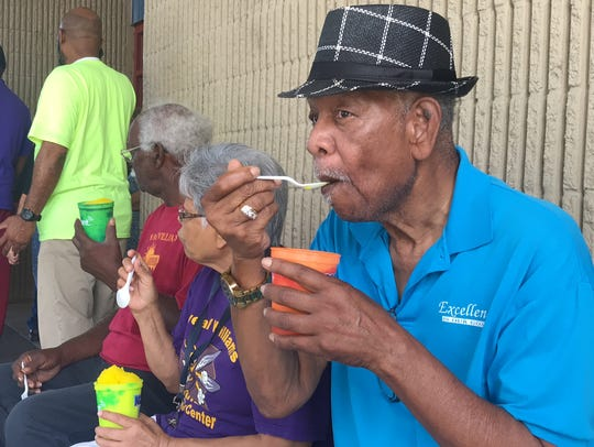 Robert Jackson 79, enjoys a snow cone outside the Oveal
