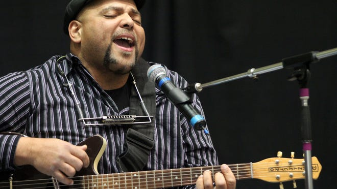 This 2010 file photo shows blues musician Kevin B.F. Burt performing at the Polk County Convention Center.