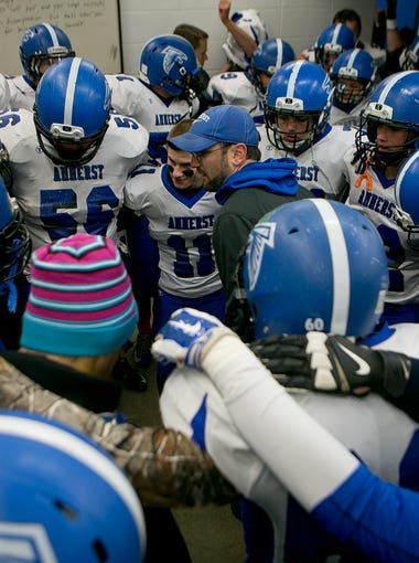 Amherst head coach Mark Lusic fires up the team in the locker room before taking on Wittenberg-Birnamwood in the regular season finale, Friday, Oct. 16, 2015.
