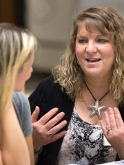 Heather Moon of York, left, talks with Kimberly Starner of Martinsburg, West Virginia, at a White Rose Mothers of Twins & Triplets Club meeting. Starner, formerly of Thomasville, attends despite the distance from her new home.