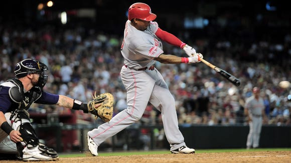 Former Reds left fielder Marlon Byrd hits a pitch against the Arizona Diamondbacks at Chase Field.