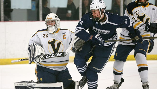 Victor goalie Chayse Ierlan tries to clear Pittsford's Austin McGrain from in front of the net.