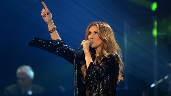 Celine Dion performs during her first of seven shows scheduled until December 5 at the Bercy's Palais Omnisports on November 25, 2013 in Paris.