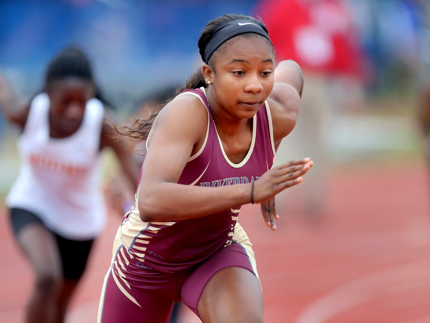Riverdale's Anastasia Hayes comes out of the block in the Class AAA 400 meter dash on Thursday at Spring Fling.