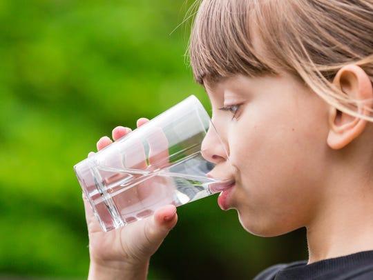 Child drinking water.