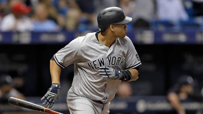 New York Yankees' Gary Sanchez drops his bat as he watches his three-run home run off Tampa Bay Rays starting pitcher Alex Cobb during the second inning of a baseball game Wednesday, Sept. 21, 2016, in St. Petersburg, Fla.