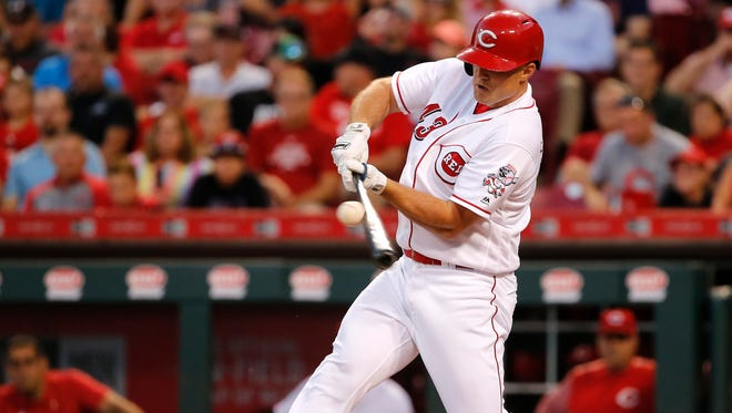 Cincinnati Reds right fielder Scott Schebler (43) hits a single in the fifth inning during the National League baseball game between the Milwaukee Brewers and the Cincinnati Reds on June 27, 2017 at Great American Ball Park.