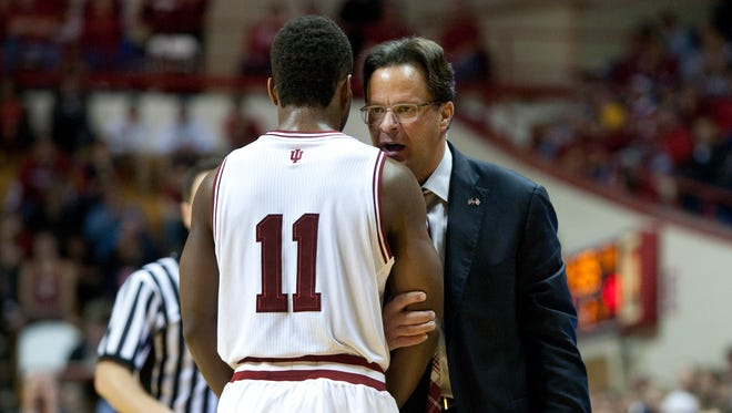 FILE -- Tom Crean talks to guard Yogi Ferrell, who is one of six IU players cited in police reports in the last nine months.