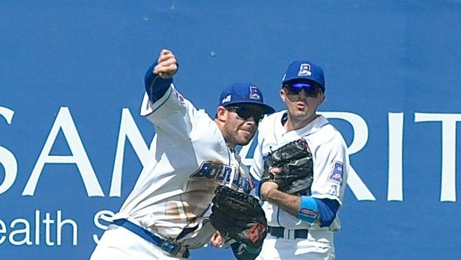 Boulders left fielder Stephen Cardullo rifles the ball back to the infield as teammate Jared McDonald looks on during a game against Shikoku Island on June 21. Cardullo holds the career mark for games played in a Boulders uniform.