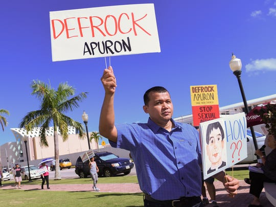 Roy Quintanilla, who accused Archbishop Anthony Apuron of sexual abuse, participates in a protest held at Dulce Nombre de Cathedral Basilica in Hagatna, Guam, on July 31, 2016.