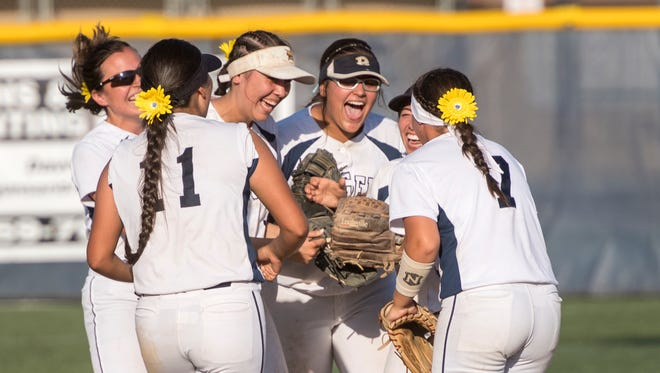 Redwood players celebrate their win over Sanger in a Central Section Division II high school semifinal softball game on Wednesday, May 23, 2018.