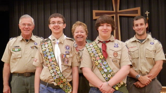 Scouts Michael Meisenburg and Matthew Warner has earned the highest recognition in Boy Scouting for their outdoor skills. From left: Ledge to Lakes District Chair Paul Hunt, Eagle Scout Michael Meisenburg, District Advancement Chair Mary Ann Salter, Life Scout Matthew Warner, and Boy Scouts Ledge to Lakes District Executive Brandon Singer. Read details below.