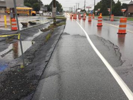 A sinkhole is extending into the eastbound lane of Route 422 near Palmyra.
