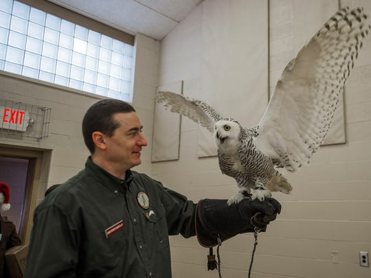 Chris Martello from the Michigan Hawking Club, holds