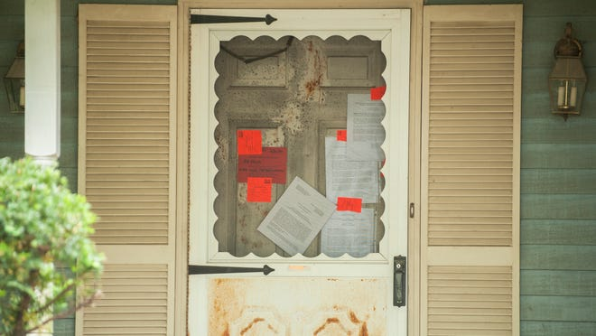 Notices are posted on the front door of a vacant house located at 38 Yale Road in Evesham.  Officials visited the house on Friday to investigate animal infestation and other possible health and saftey issues.  05.30.14