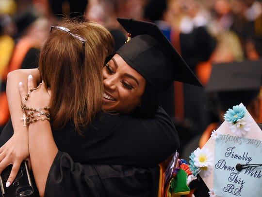 William Paterson graduates hug after accepting their