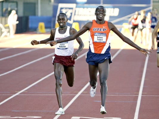 UTEP's Anthony Rotich, right, wins the men's steeplechase ahead of Arkansas' Stanley Kebenei during the NCAA track and field championships in Eugene, Ore., Friday, June 12, 2015.  (AP Photo/Don Ryan)