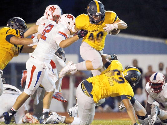 MARK LAMBIE—EL PASO TIMES  Eastwood running back Joseph Davalos leaps over teammate Noah Garcia at the line of scrimmage during the Troopers' game Friday night against Bel Air.