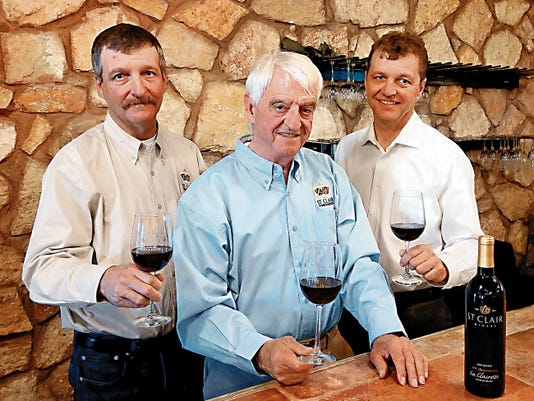 Courtesy Photo   The St. Clair family winemakers, from left, Emanuel Lescombes, Herve Lescombes and Florent Lescombes have celebrated over 30 years of winemaking in Luna County.