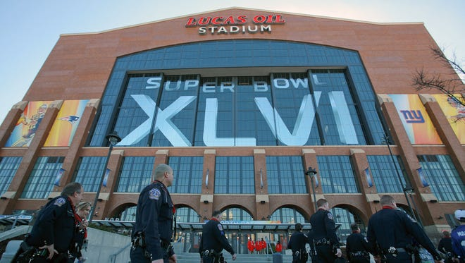 IMPD officers file past the stadium in mass during Super Bowl XLVI, Feb. 5, 2012, at Lucas Oil Stadium in Indianapolis, Ind. Michelle Pemberton/The Indianapolis Star)