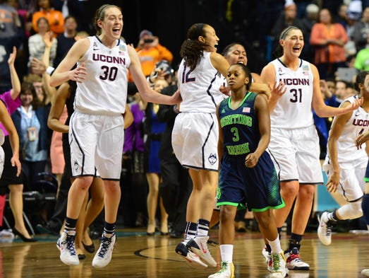 Connecticut Huskies center Stefanie Dolson, right, and forward Breanna Stewart, left, react after defeating Notre Dame at Bridgestone Arena.