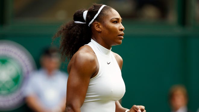 Serena Williams celebrates after beating Annika Beck to join Martina Navratilova as the only women with 300 victories at major tournaments in the Open era.