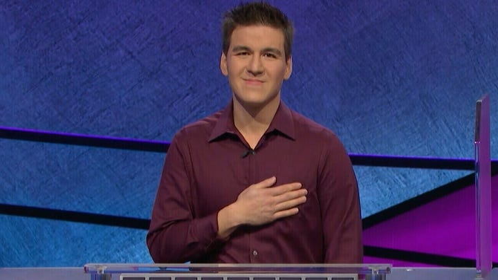 """FILE - This file image made from video aired on """"Jeopardy!"""" on Tuesday, April 9, 2019, and provided by Jeopardy Productions, Inc. shows James Holzhauer. The 34-year-old professional sports gambler from Las Vegas won more than $110,000 on """"Jeopardy!"""" on Tuesday, breaking the record for single-day cash winnings. Holzhauer won $131,127 during a show aired Wednesday night, April 17, 2019, breaking the record that viewers saw him set last week.(Carol Kaelson/Jeopardy Productions, Inc. via AP, File) ORG XMIT: CAET468"""