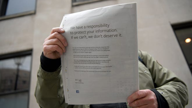 "A copy of 'The Observer' shows an advertisement paid by Facebook in London, March 25, 2018. Facebook Chief Executive Mark Zuckerberg apologized for a ""breach of trust"" involving misused data from millions of Facebook users. The ads also appeared in The New York Times, Washington Post and Wall Street Journal."